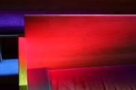 stained glass light on church pew