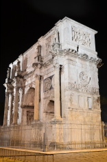 Triumphal Constantine Arch nearby Colosseum in Rome by night, It