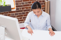 Concentrated woman working at desk