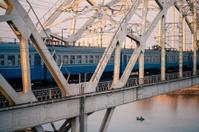 train on the railway bridge across Dnepr river
