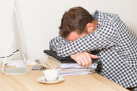 Young man working at home, burnout