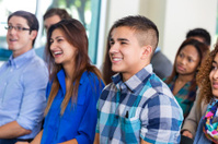 Diverse students listening to speaker in lecture or class