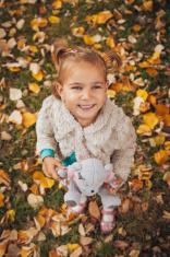 Cute little girl teddy bear in hand