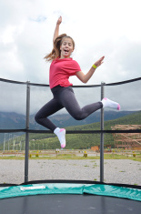 Teenage girl jumping on a trampoline