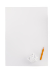 pencil and crumpled paper ball on white