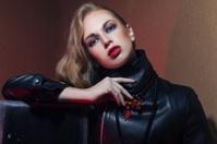 Beautiful woman in black leather dress