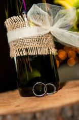 Wine bottle and wedding rings