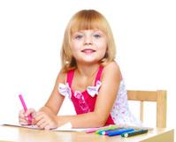 little girl draws.