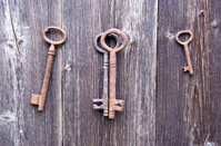 old rusty key on farm barn wooden wall