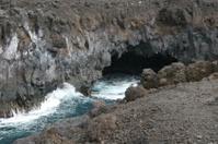 water splashing against volcanic rocks