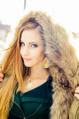 Beautiful woman portrait with a fur coat