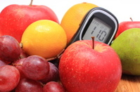 Fresh natural fruits with glucose meter