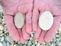 Pebbles in the hand, closeup