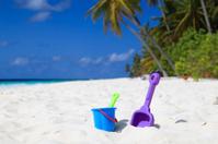 kids toys on tropical beach