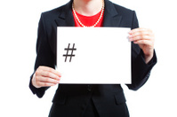 Businesswoman Holding a Hashtag Sign