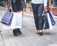 Two Young Friends Doing Shopping