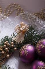 An Angel with Christmas wreath and Christmas Balls