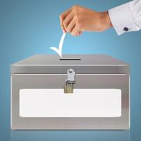 Hand with ballot and metal box