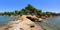 Panorama of the stone ledge in Aegean Sea.