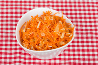 grated carrot with pineapple on the tablecloth