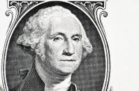 portrait of president Washington on an one dollar bill.