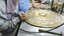 workers castigate bronze casting products, vietnam