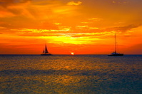 Dramatic sunset and ships in Palm Beach, Aruba, Caribbean Sea