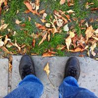 Feet on the sidewalk tiles.