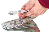 Hands and hundred dollar bills