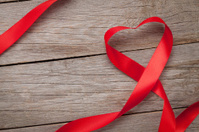 Valentines day heart shaped ribbon over wooden table background