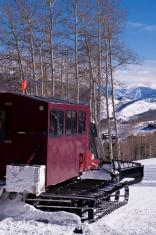 Alpine Snowcat in the Mountains