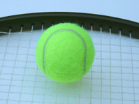 tennis ball with racquet