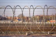 barbed wire netting outside railroads