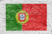 Flag of Portugal painted on brick wall