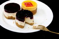 three small fancy cakes