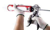 Worker applies silicone caulk gun isolated