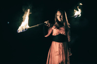 active European girl carries out tricks fire show night
