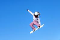 Snow boarder flying