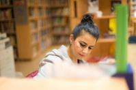 Portrait of Female Librarian, Teacher, Working at University Lib