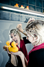 Angry Woman Holding Toothbrush to Rubberduck