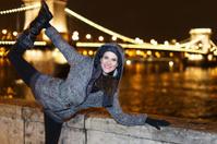 Dynamic woman posing at night