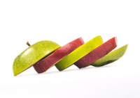 sliced multicolored apple on white background