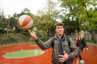 Male Turkish Student Juggling with Ball, Campus, Istanbul, Turke