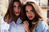 two female friends posing