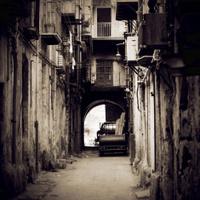 Narrow Street Between Buildings in Italy