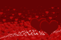 Two dark hearts on blurry hearts background