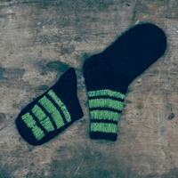 woolen socks on wooden background