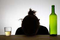 Silhouette of a drunk woman sleeping on a desk