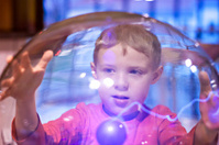 Child boy playing Tesla Ball