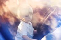 Little child in car.